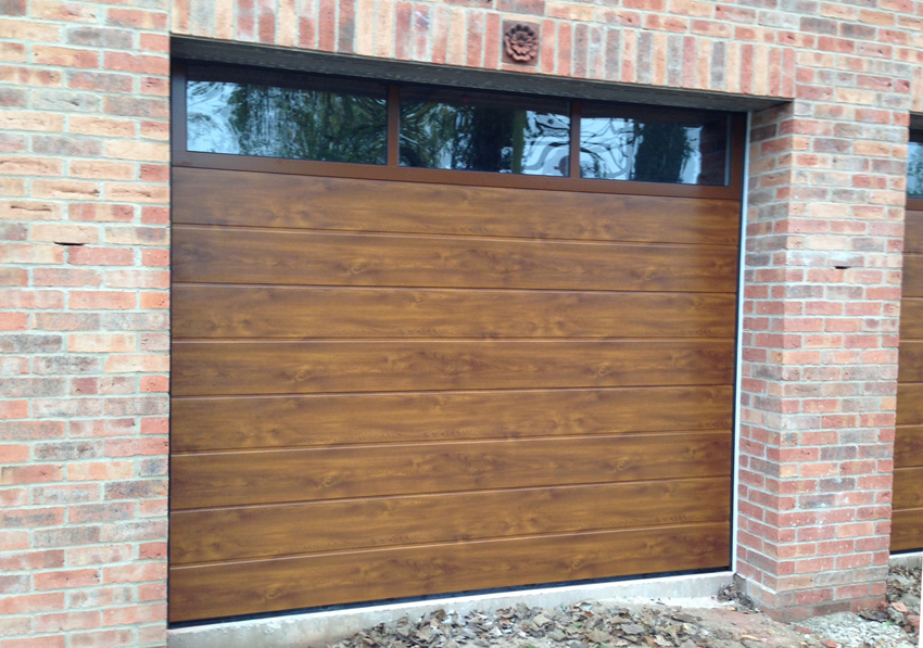 Secure And Insulated Peak Garage Doors