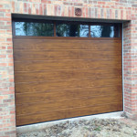 This customer wanted an insulated door, high security and windows. Hormann Sectional doors have a wide range of window options.