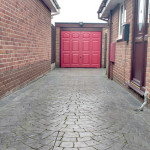 Red seems to go well with Rosewood soffits and fascias. Nice work on the drive here which we can't take credit for.