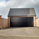 This was a new build on a housing estate. Like many new builds, it had two narrow up and doors that our client could not get his car through. We knocked out the central pillar, put in a heavy duty lintel and a double Hormann sectional. With an insulated door our customer insulated the rest of the garage to make the perfect workshop.